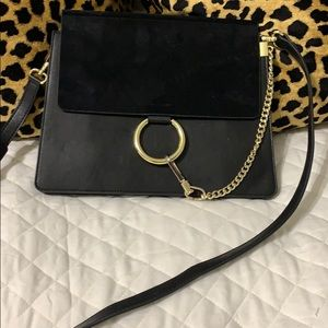 Trendy Black suede and leather circle closure bag